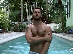 Hot strigous guy relating to the pool and shower