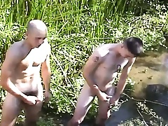 Three beautiful and randy soldiers masturbate together in the outdoors